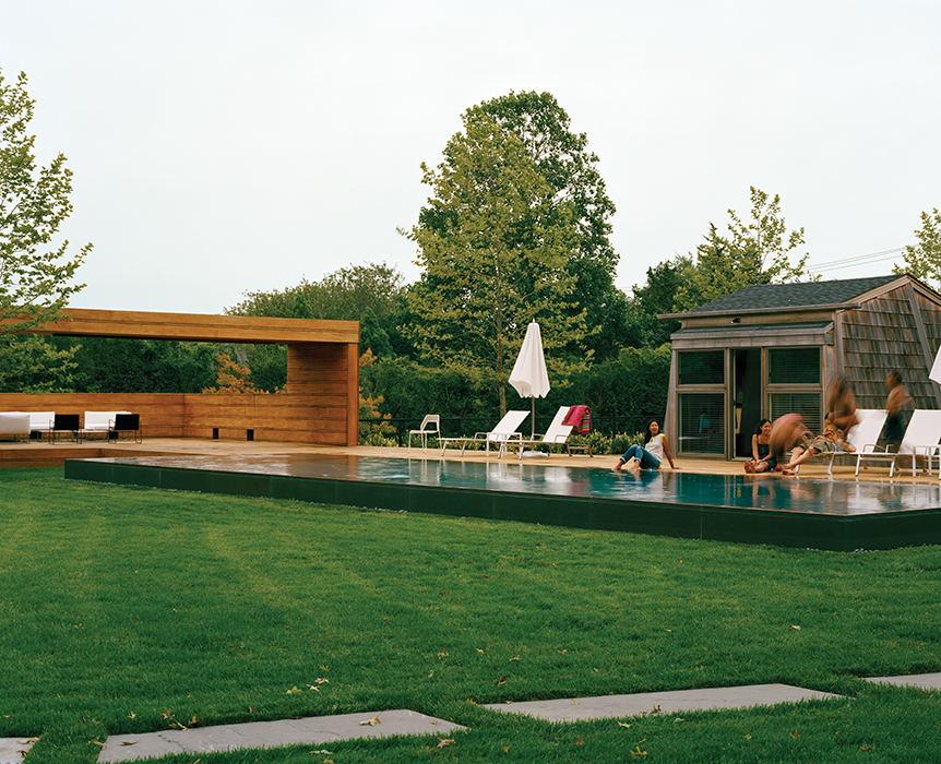 Tiny pool house by a minimal pool in Long Island