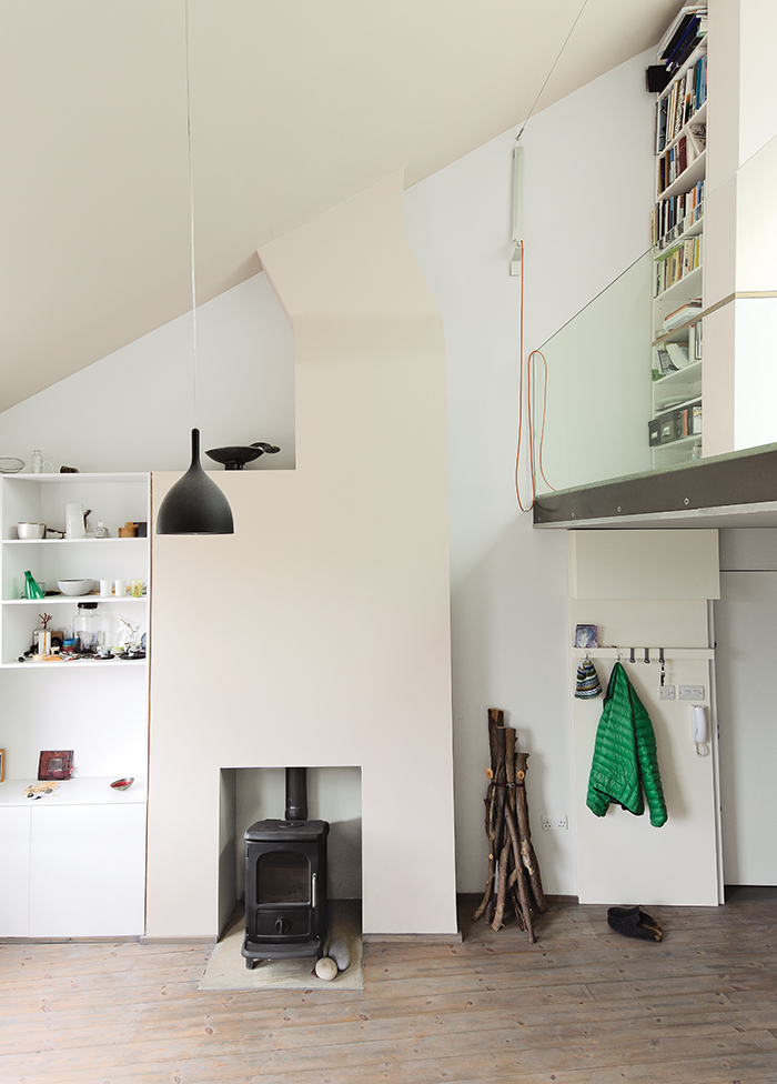White interior with a wood burning stove and storage shelves