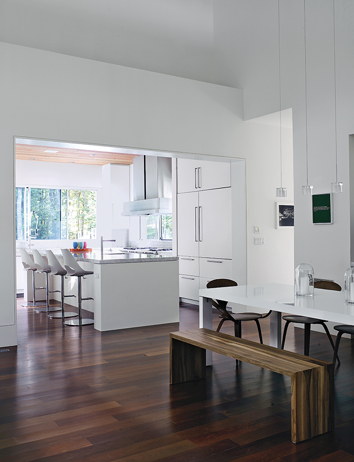 Kitchen with white marble countertops and white fiberboard cabinetry