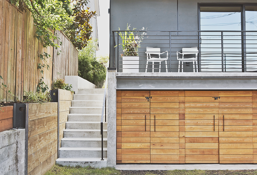 Modern multifamily home in Seattle with cedar doors on the garage