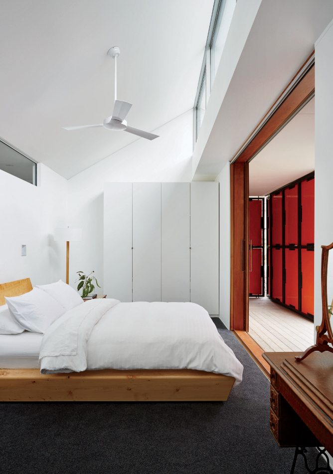 IKEA wardrobe and Rye Dunsmuir bed in Tasmanian prefab by Misho+Associates.