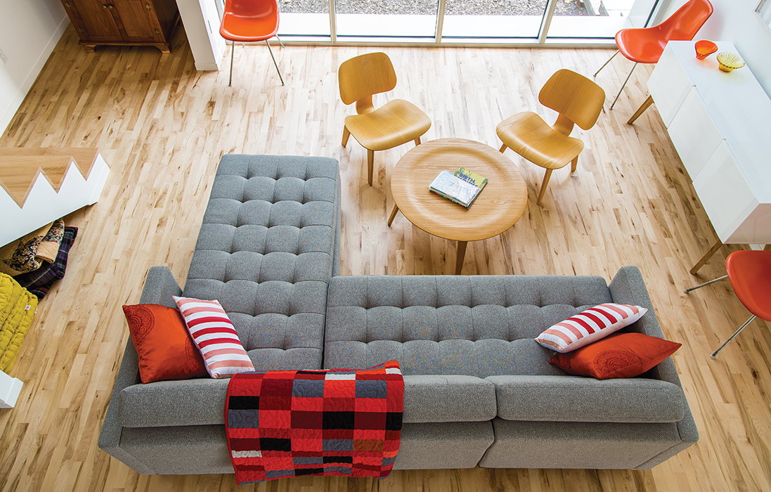 Affordable Kansas City home with cb2 sectional sofa and maple floors in the living room