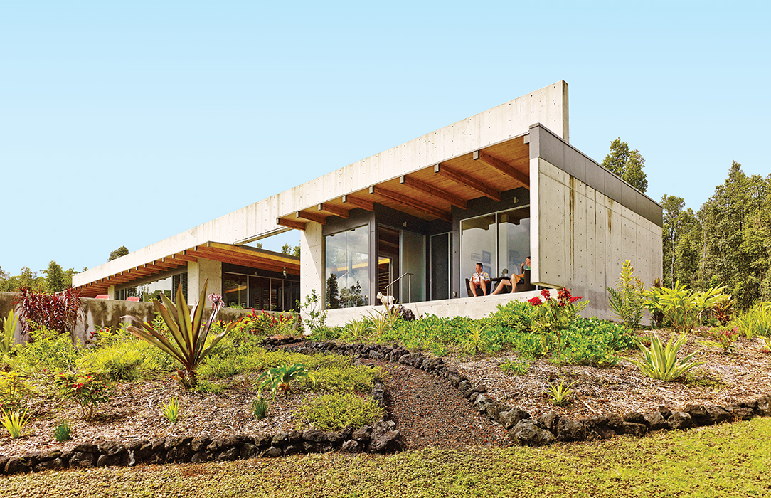 Concrete beam going across the roof of a modern Hawaiian home