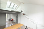 White staircase with skylight and under-stair storage