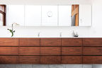 light and shadow bathroom walnut storage units corian counter vola faucet