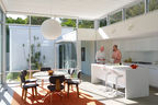 Modern Florida seaside home with corian island, dornbracht faucet, cees braakman combex chairs and marble knoll table in the kitchen