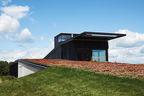 el top rises wisconsin facade sedum green roof