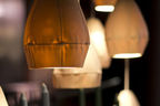 Sculptural pendant light cast from leather mold