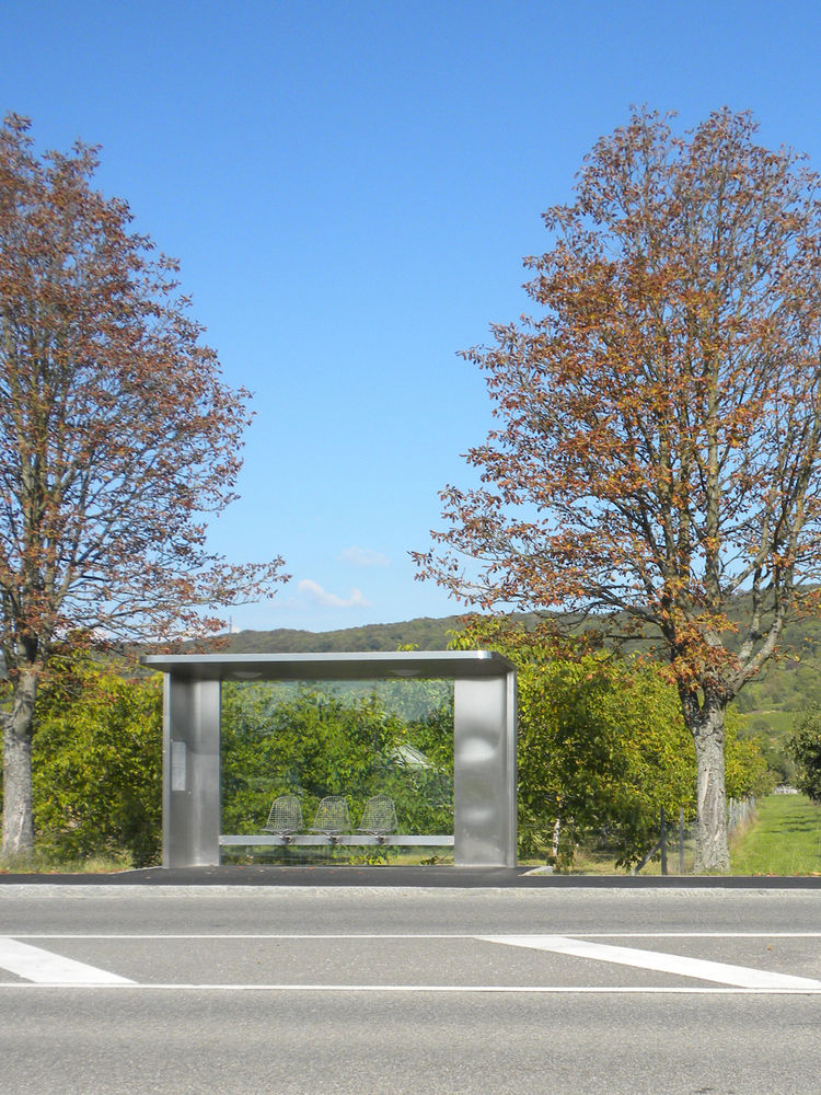 """Before even setting foot on the Vitra Campus, guests who travel by bus (like me) are welcomed by bus shelters designed in 2006 by <a href=""""http://www.dwell.com/people/jasper-morrison.html"""">Jasper Morrison</a>."""