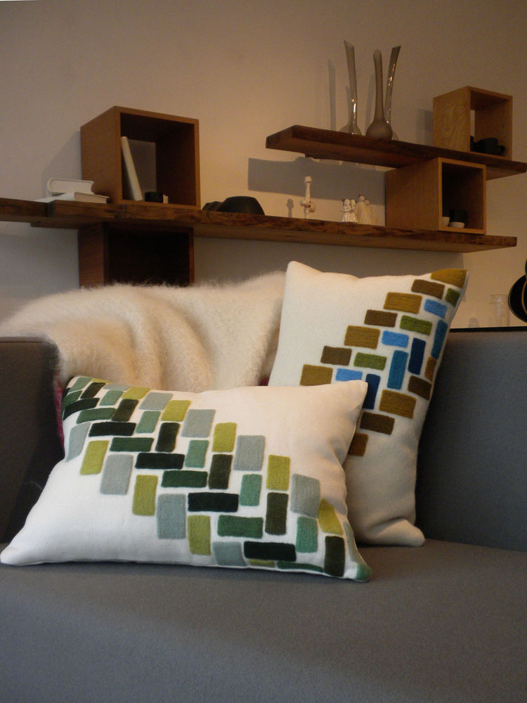 "Topping the Cubert Love Seat by <a href=""http://www.sixoeight.com/"">608 Design</a> is a pair of Storeys Cushions by <A href=""http://www.kerrycroghan.com/"">Kerry Croghan</a>."