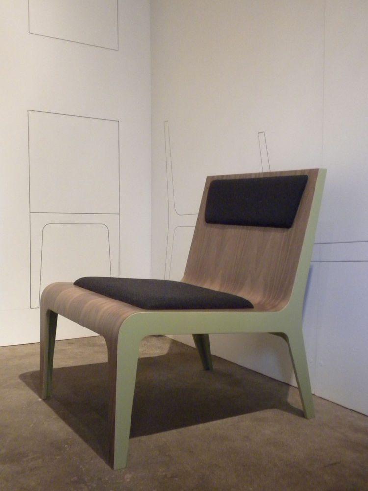The exhibition featured three chairs representing variations on a theme. The walls were lined with printouts of the chair template that was the starting point for each prototype. The chairs will be on display through April 30.