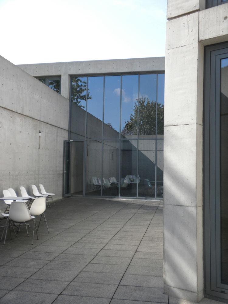 The lower level of Ando's two-story structure is sunken below the ground. From the inside, the top of the concrete wall that surrounds the courtyard lines up so that it appears as if the cars driving on the road next to the building are driving on top of