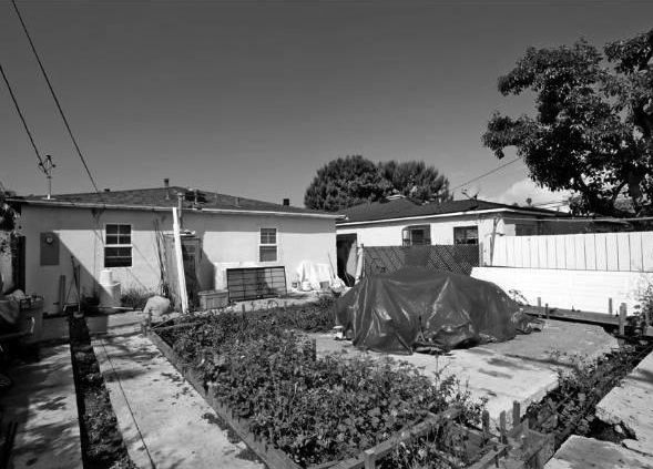"""The previous homeowners had taken the effort to get the necessary permits to build a new structure where the freestanding garage once stood. They demolished the existing garage and stripped down, but ran out of money to complete the project. """"It was kind"""