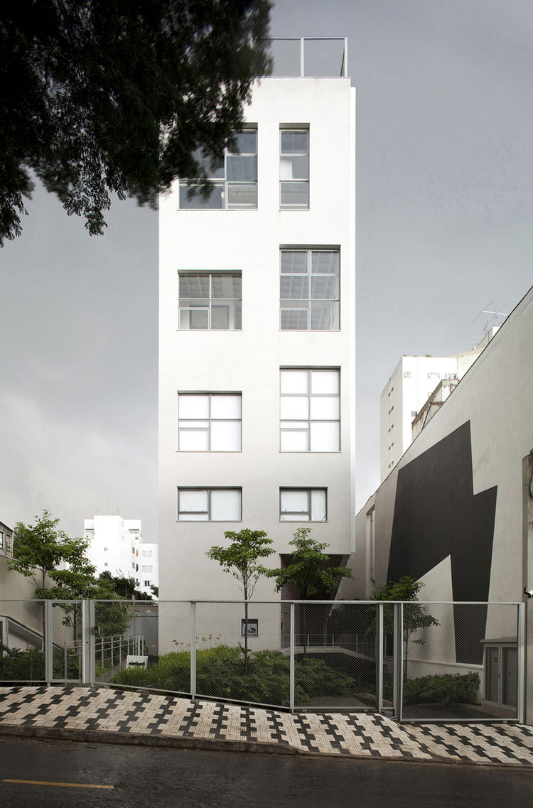 "Vinícius Andrade and Marcelo Morettin, of <a href=""http://www.andrademorettin.com.br/"">Andrade Morettin Arquitetos</a> designed the Aimberé residential building to include 12 varying units with flexible floorplans on nine levels, and set it back from the"