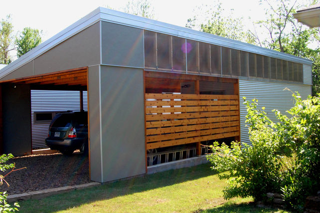 "Although it serves as one half of the wing-like silhouette, the carport wasn't detached solely for curb appeal. ""The carport versus an attached garage means that paint and chemical fumes don't follow us into the house every time we go inside,"" says Myria."