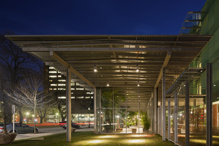 Evening exterior view of the new Evans Way Park entrance of the Renzo Piano-designed wing of the Gardner Museum, which houses a 2,500-square-foot greenhouse.