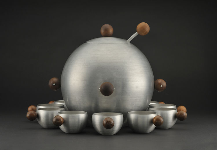 "Russel Wright's circa 1935 aluminum-and-walnut punch bowl with 12 cups reflects his ""aim to reach a broad range of consumers, especially in the Depression years."" Photo by <a href=""http://www.denisfarley.net/index.htm"">Denis Farley</a>."