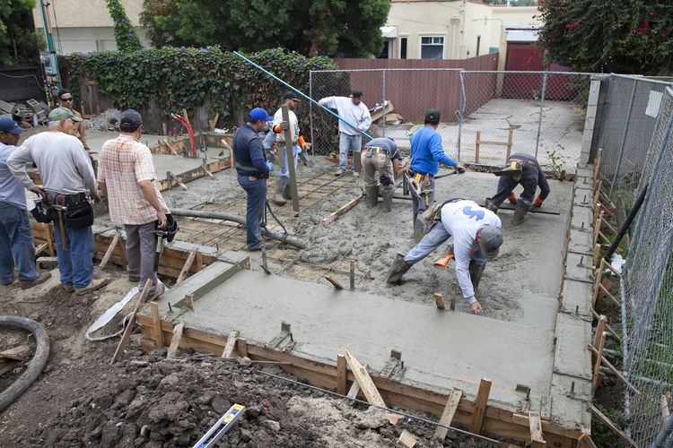 The concrete crew works as a team.