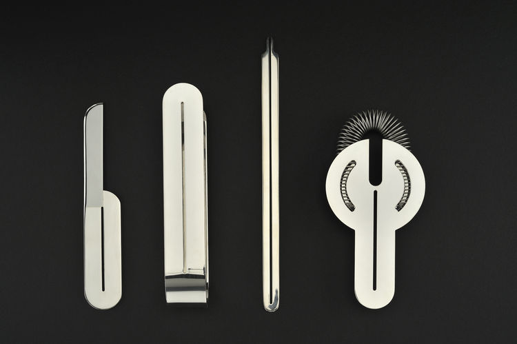 "A set of circa 1972 silver bar tools—strainer, stirrer, tongs and knife—by the Italian design couple Lella and Massimo Vignelli for San Lorenzo. Photo by <a href=""http://www.denisfarley.net/index.htm"">Denis Farley</a>."