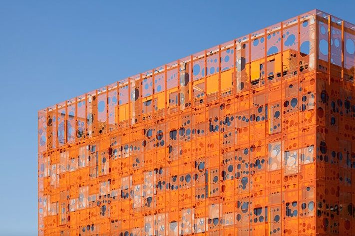 The orange facade of the Jakob + MacFarlane-designed Orange Cube in Lyon, France.
