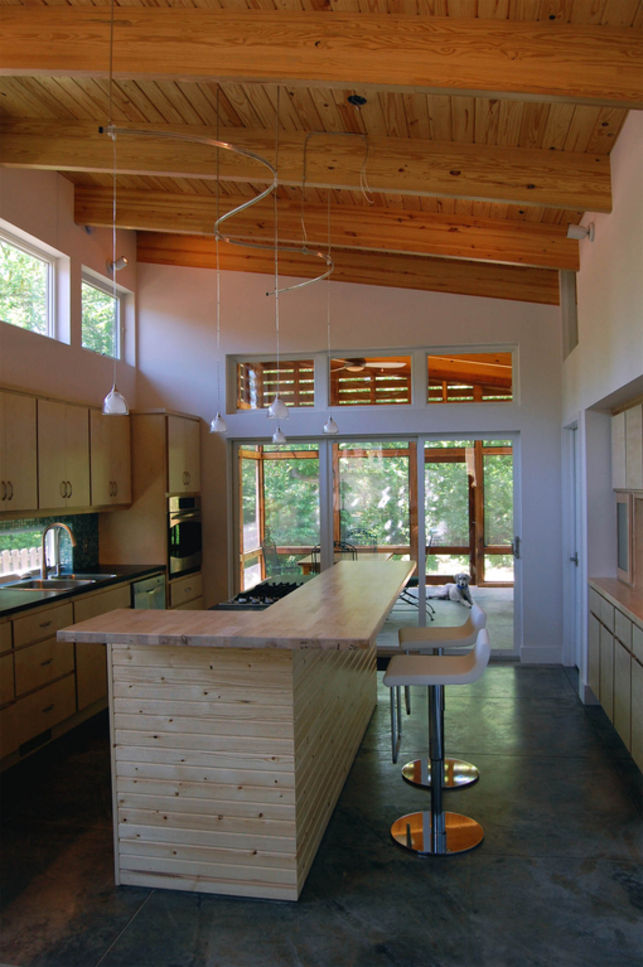 "The couple thought carefully about the materials used in the cabinetry and also the installation work. ""The same men who did all the building also did the custom-made cabinets; we wanted to keep local people working during the recession versus ordering th"