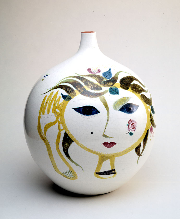 Conceptualized around 1951 by Swedish designer Stig Lindberg for the Gustavsberg porcelain company, this vase bears more whimsical forms than the work of his midcentury modern contemporaries—many of whom were more concerned with strict industrial designs.