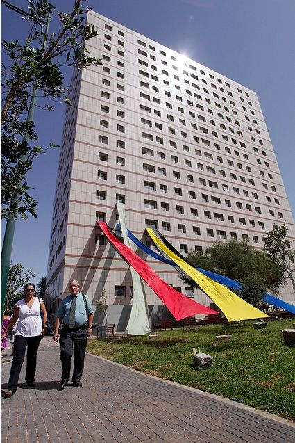 A view of the Dasding Hofmann's 'Lobby' project, with colorful banners stretching down from the Tower building.