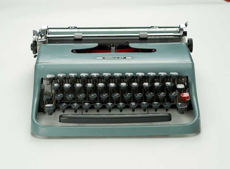 "The enameled-metal Lettera 22 typewriter, designed by Marcello Nizzoli for Olivetti in 1950. The machine had a single, bright-red return key and a handy carrying case. Photo by <a href=""http://www.denisfarley.net/index.htm"">Denis Farley</a>."