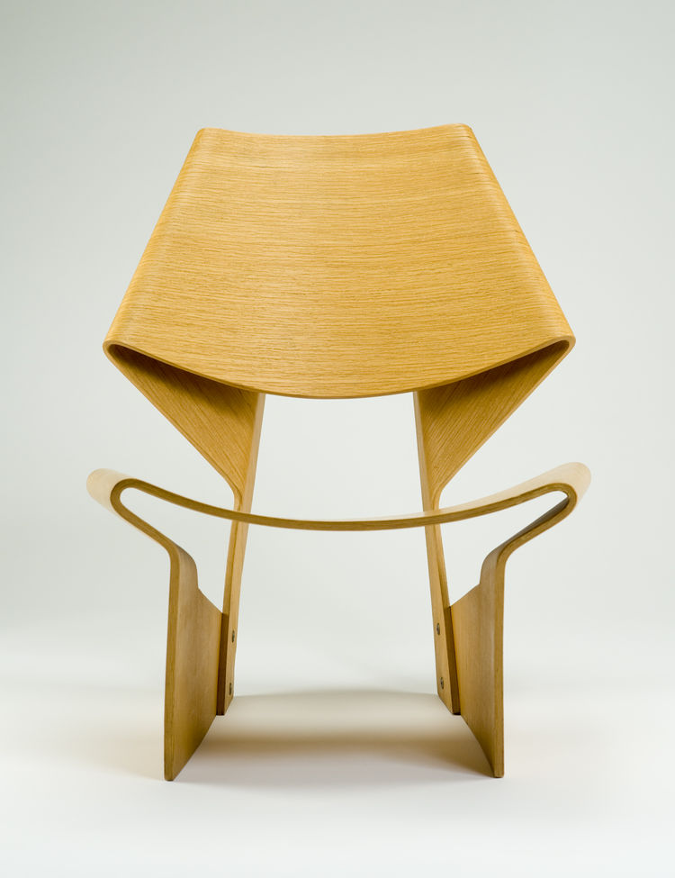 "Danish designer Grete Jalk designed this beech-faced plywood-and-steel GJ chair as part of a laminated furniture series in 1963; it won Britain's Daily Mail International Furniture Competition the same year. Photo by <a href=""http://www.denisfarley.net/in"