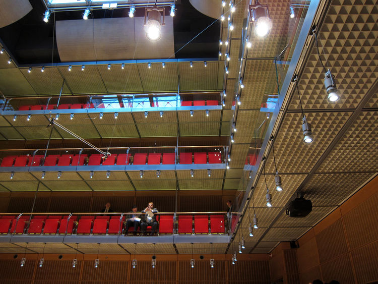 The underside of the vertically-oriented Caldwell Auditorium, built like a high-tech black box theatre.
