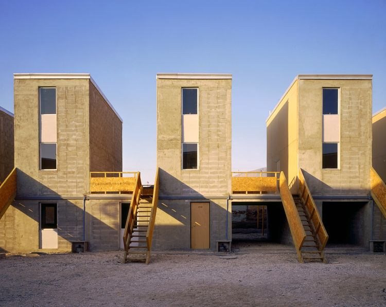 The Incremental Housing project in Iquique, Chile, and Monterrey, Mexico produces half-finished houses that are completed by the residents and contain only the essentials of a built home—bathroom, kitchen, structure and roof—in order to stretch resources