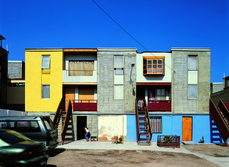 """An """"after"""" photo of Incremental Housing, after the residents have filled in the rest of the structure, expanding their own living spaces."""
