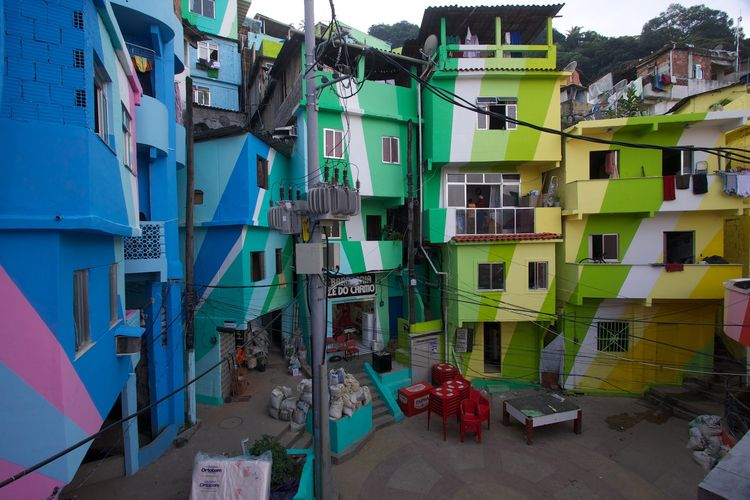 Praça Cantão Favela Painting project in Santa Marta, Rio de Janeiro, where artists engaged community members to paint the building exteriors in their neighborhood, calling international media attention to their need for improvement. Photo courtesy Austr