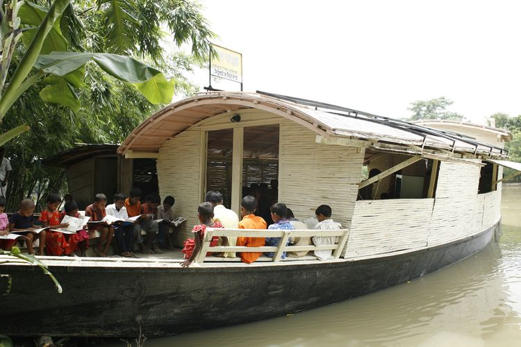 Floating Community Lifeboats in Bangladesh provide space for solar-powered schools, libraries, clinics and community centers in response to rising waters and extreme density. Photo courtesy of Abir Abdullah/Shidhulai Swanirvar Sangstha.