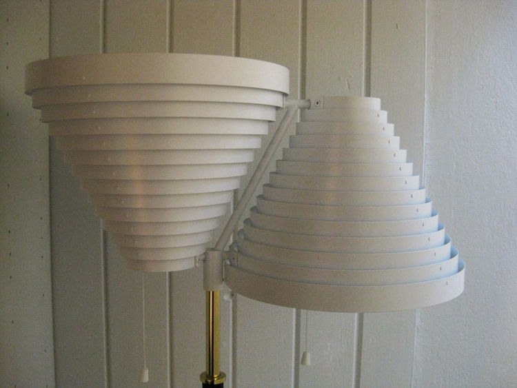 """Aalto's repetitive use of gradually-stepped concentric rings earned this fixture the name """"Lattiavalaisin"""" (or Standard lamp). This is model A810."""