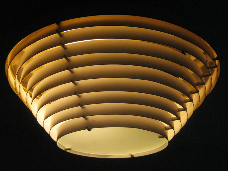 A copper variation of ceiling fixture A622 casts a soft glow in the atelier's portico. A larger version of this fixture was used in the administrative floors of the Finance Department.