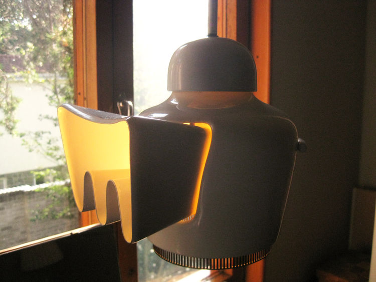 """In another of the bedrooms is an unusual variation of Aalto's famous """"golden bell"""" fixture. The light was originally developed for Helsinki's Savoy Restaurant, which Aalto designed in 1937."""