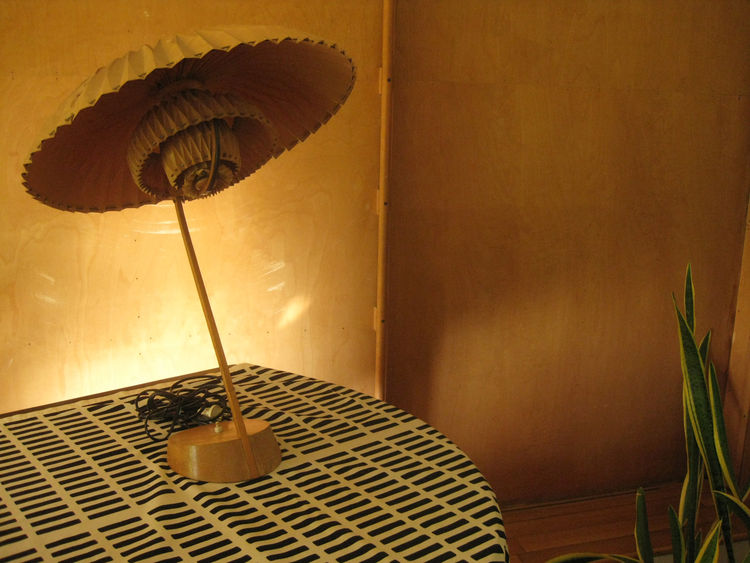 One of the few lights in Aalto's home not designed by the architect is this folded paper lamp that graces the living room piano. It was given to Aalto by Danish designer Poul Henningsen during World War II. At the time Henningson was living in Sweden and