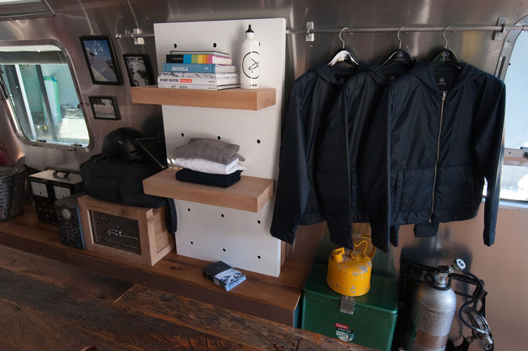 """Call it a kind of """"brand experience"""" but you're meant to enter Aether's world inside the Airstream, and the other objects (books, camping gear) all reinforce the idea of a well-curated manly getaway."""