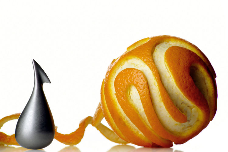 Apostrophe orange peeler, by LPWK - Gabriele Chiave for Alessi.  This small peeler will allow you to eat a ripe orange without ending up with rind underneath every fingernail.