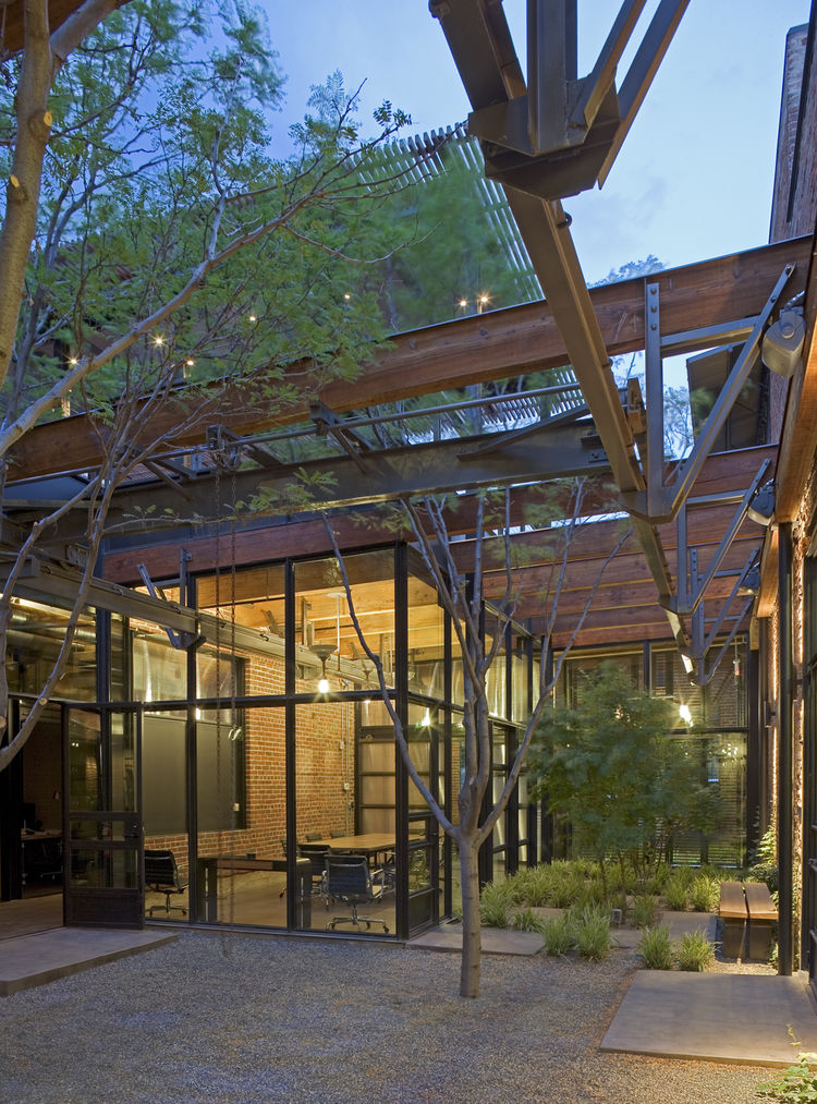 "Armstrong Oil and Gas in Denver, Colorado. Designed by Lake|Flato Architects. Winner of the 2011 Institute Honor Award for Interior Architecture. Project description: ""The adaptive re-use of a 1900s machine shop celebrates the spirit, craft and materialit"