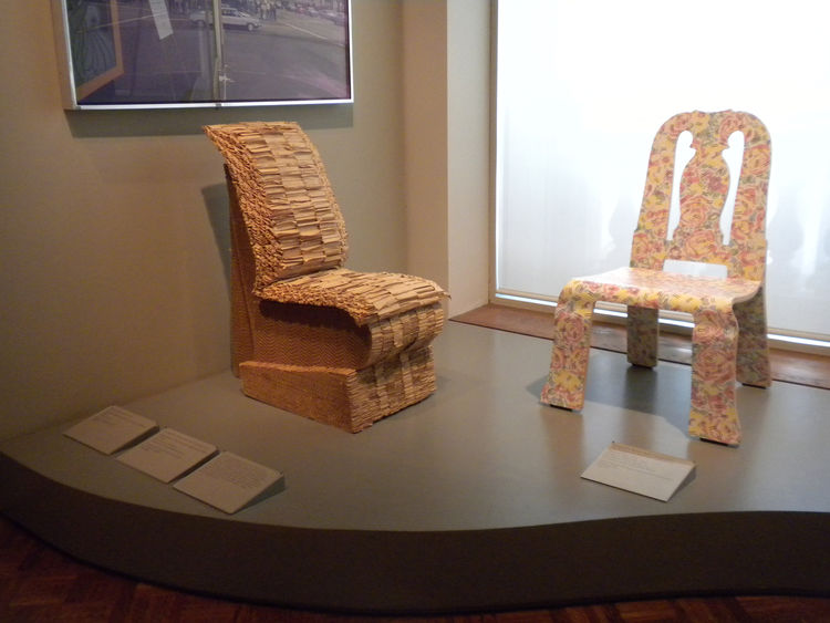 Here, one of Frank Gehry's cardboard chair creations and a seat by Robert Venturi.