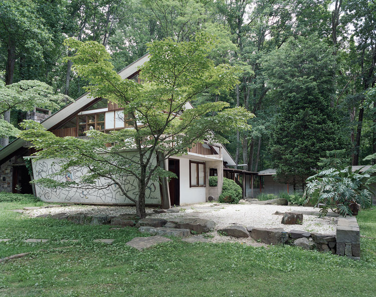 "American furniture designer George Nakashima made his home in New Hope, Pennsylvania. ""Nakashima embraced construction as a kind of improvisation, noting that 'the house was built without plans, and the detailing was developed from the material on hand or"