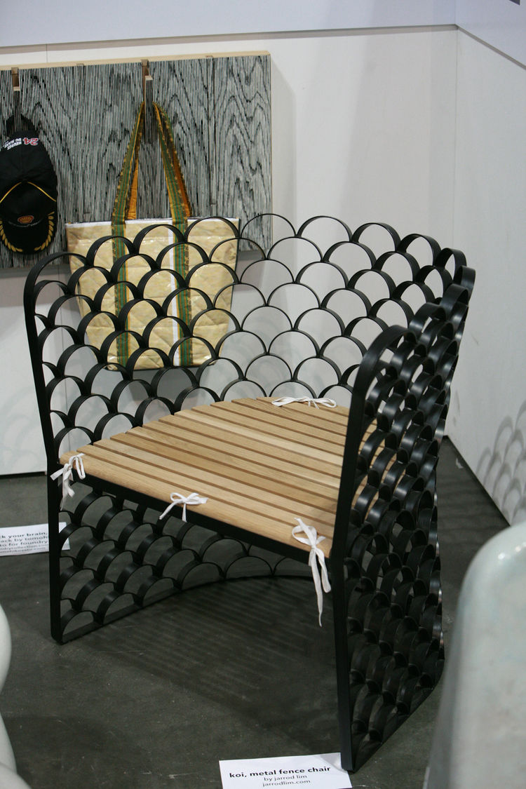 From Singapore comes the lovely Koi Metal Fence Chair by Jarrod Lim. I love the geometric repetition of the design, whose stark metal lines are cut with just a touch of whimsy: small cloth ties.