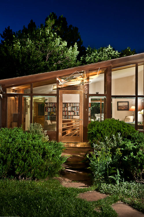 Michl's awning was devised to replace a previous wooden one that blocked views of the nearby mountains. See how the awning catches the light at night, yet another benefit of the crystalline design.