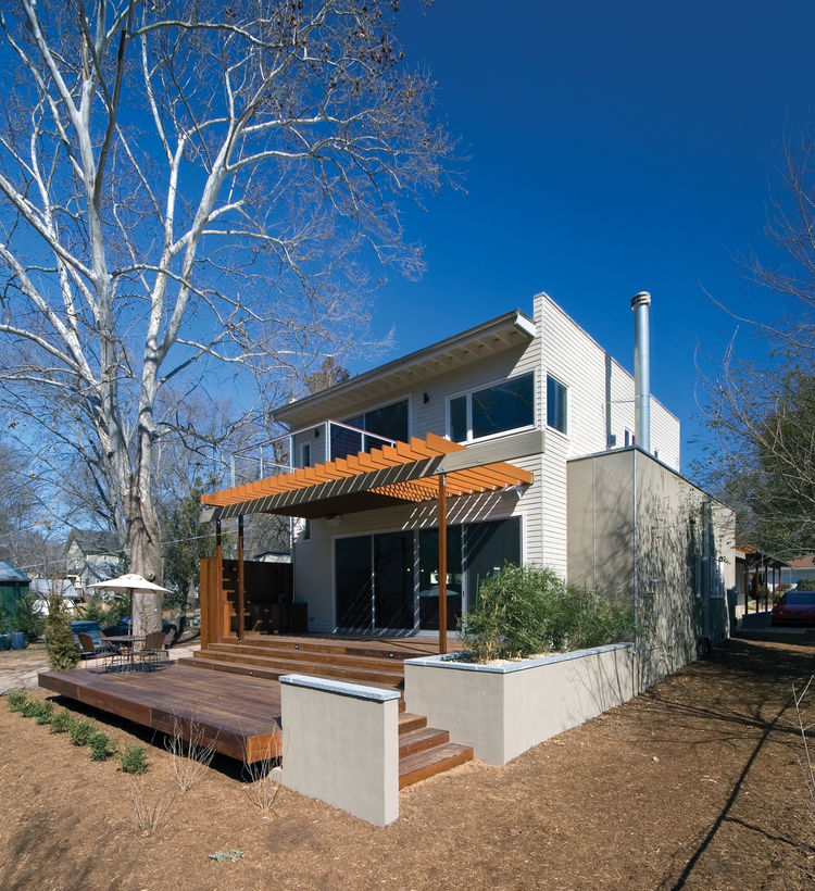 Instead of demolishing the existing house or adding a second story, the addition was added at the rear of the existing structure, separated by a new main entry courtyard. These new, public spaces take advantage of a connection to outdoor spaces at the rea