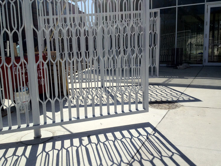 """The front gates of the new visitors center with gates that pivot on a central axis, all designed by Weiss/Manfredi. The welcome area is positioned as an """"urban gesture"""" right off Washington Avenue, according to co-founder Michael Manfredi, and you get a s"""