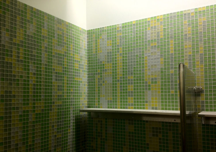 Weiss/Manfredi plotted out the green bathroom tiles according to pixelated photos of the botanic gardens.