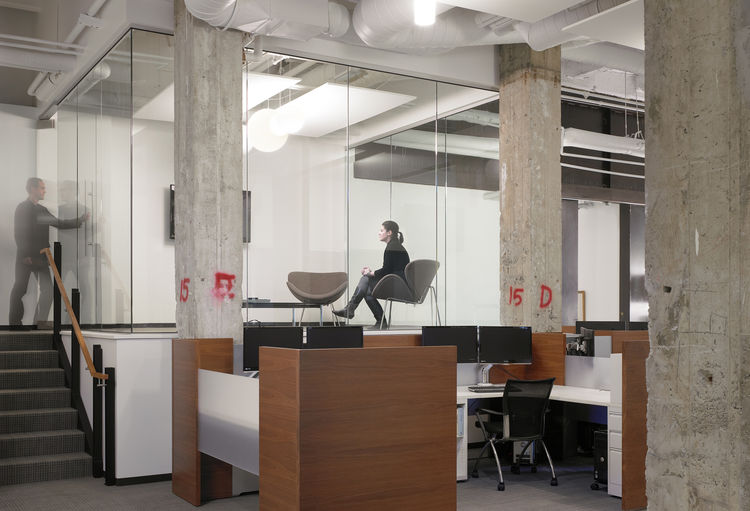 The office, located in the historic Bently Reserve building, combines new and old construction for a practice that works with new and old financial traditions.