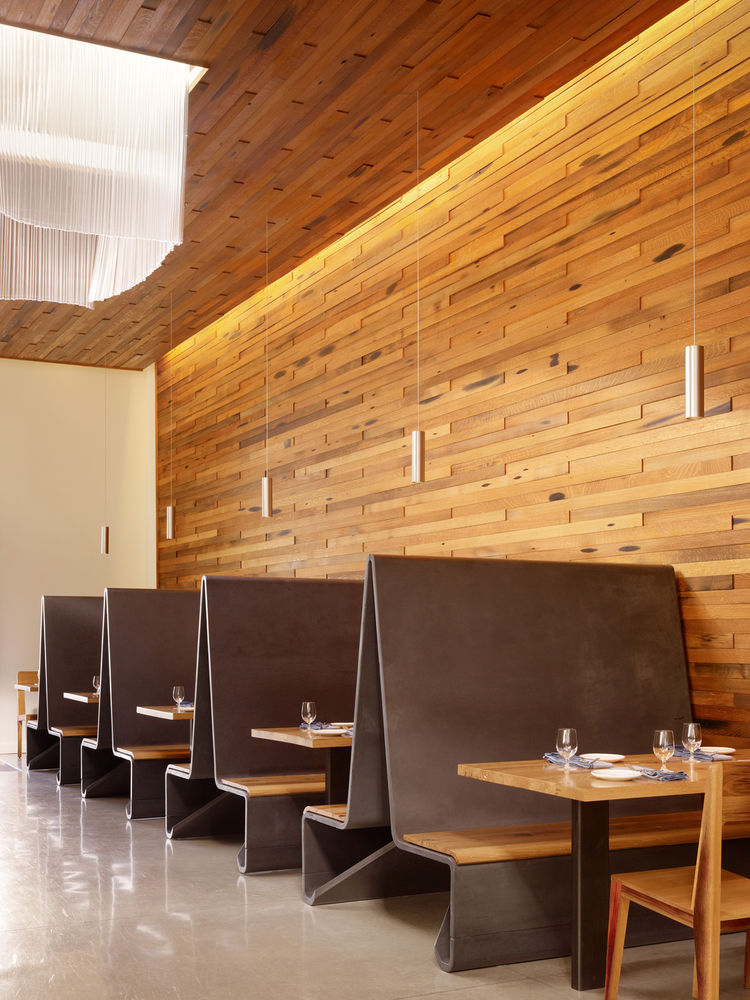 An old warehouse was converted into the restaurant. The walls are made of reclaimed oak from former whiskey barrels.